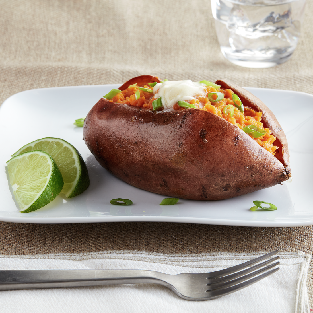 recipe image Buttery Baked Sweet Potatoes With Coconut & Lime